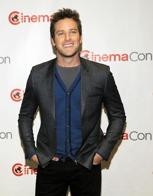 """Armie Hammer, who stars in the title role in the upcoming film """"The Lone Ranger,"""" poses backstage during the Walt Disney Studios presentation at CinemaCon 2013 at Caesars Palace on Wednesday, April 17, 2013 in Las Vegas. (Photo by Chris Pizzello/Invision/AP)"""