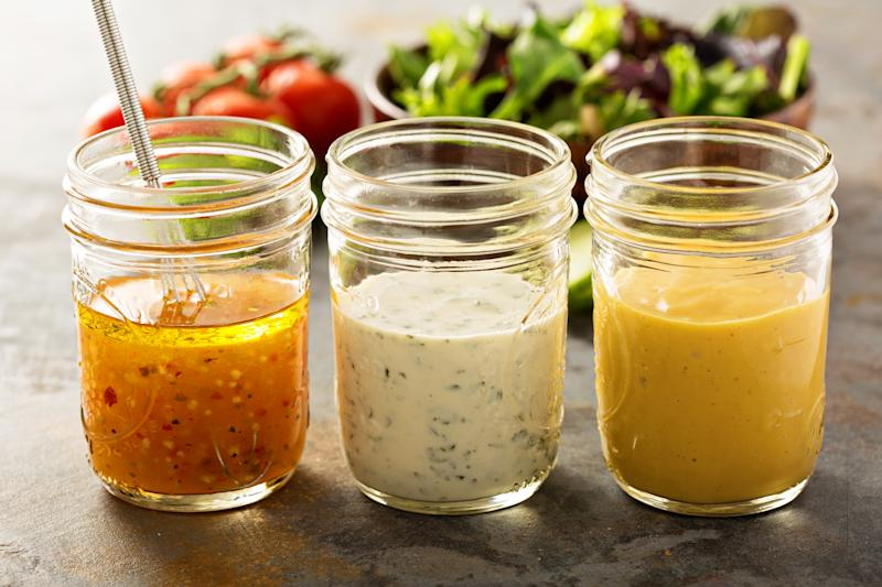 Variety of homemade sauces and salad dressings in mason jars