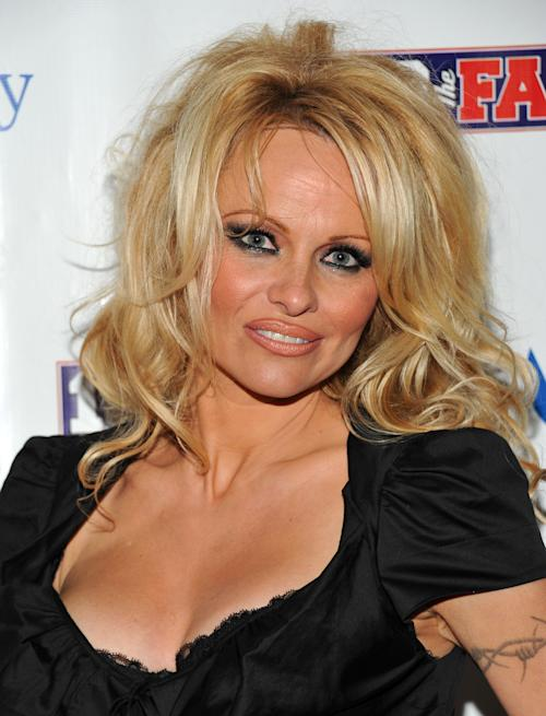 "FILE - This Feb. 4, 2011 file photo shows actress Pamela Anderson arriving to host the Dallas SuperBash 2011 Super Bowl party at the Fashion Industry Gallery in Dallas, Texas. ABC says an ""All-Star"" edition of the competition show will bring back 12 former rivals including Pamela Anderson, Kristie Alley, and Bristol Palin. In a break from the past, viewers can vote online for the 13th contestant from three former contestants including actors Kyle Massey and Sabrina Bryan and celebrity stylist Carson Kressley. The celebrity dance competition series returns on ABC on Sept. 24.(AP Photo/Evan Agostini, file)"