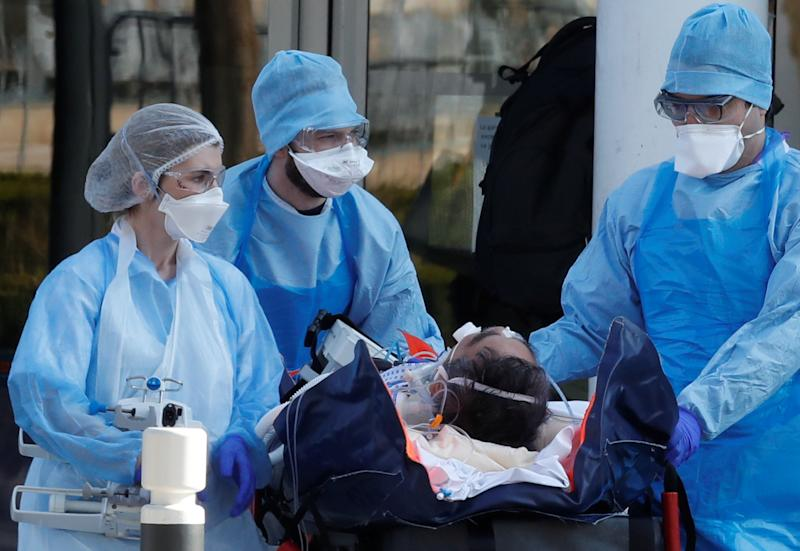 Medical staff move a patient from a special high-speed train to an ambulance during a transfer operation of people infected with coronavirus disease (COVID-19), from Strasbourg to western France hospitals, in Angers, France March 26, 2020. REUTERS/Stephane Mahe