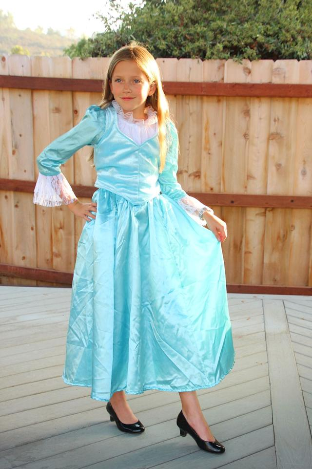 "<p>This DIY Eliza look seems complicated, but there's actually no sewing required! Simply pair this light blue two-piece dress with a pair of character shoes. The best part? It's budget-friendly, too.</p><p><a class=""body-btn-link"" href=""https://www.amazon.com/Forum-Womens-Colonial-Corset-Style-Dress/dp/B06XNM1M7V/ref=sr_1_4?crid=26151AQIS5JJV&dchild=1&keywords=eliza+hamilton+dress&qid=1598658285&sprefix=eliza+h%2Caps%2C156&sr=8-4&tag=syn-yahoo-20&ascsubtag=%5Bartid%7C10055.g.33836165%5Bsrc%7Cyahoo-us"" target=""_blank"">SHOP DRESS ON AMAZON</a> </p><p><em><a href=""https://highlightsalongtheway.com/eliza-hamilton-dress/"" target=""_blank"">See more at Highlights Along The Way »</a></em></p>"