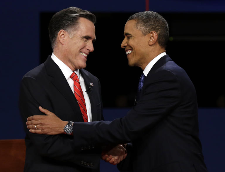 Republican presidential nominee Mitt Romney and President Barack Obama shake hands during the first presidential debate at the University of Denver, Wednesday, Oct. 3, 2012, in Denver. (AP Photo/Charlie Neibergall)
