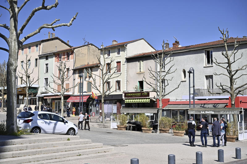 Police officers patrol after a man wielding a knife attacked residents venturing out to shop in the town under lockdown, Saturday April 4, 2020 in Romans-sur-Isere, southern France. The alleged attacker was arrested by police nearby, shortly after the attack. Prosecutors did not identify him. They said he had no documents but claimed to be Sudanese and to have been born in 1987. (AP Photo)