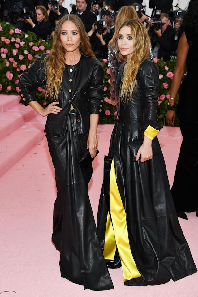 Proving leather works wonders on the pink carpet, fashion's favourite twins wore matching vintage Chanel ensembles at the 2019 Met Gala. <em>[Photo: Getty]</em>