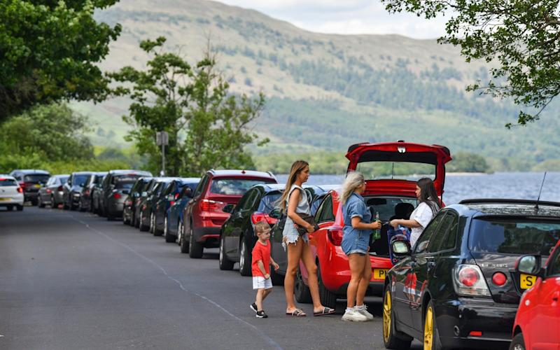 Scots ignored guidelines and flocked to beauty spots such as Loch Lomond over the weekend - Jeff J Mitchell/Getty
