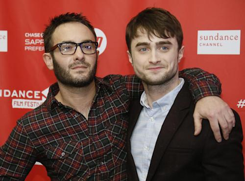 """Director John Krokidas, left, and actor Daniel Radcliffe pose at the premiere of """"Kill Your Darlings"""" during the 2013 Sundance Film Festival on Friday, Jan. 18, 2013 in Park City, Utah. (Photo by Danny Moloshok/Invision/AP)"""