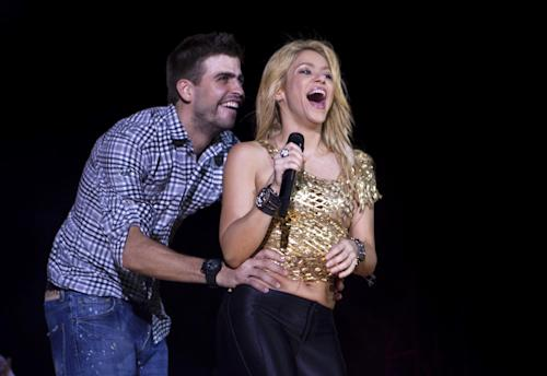 "FILE - This May 29, 2011 file photo shows Colombia's singer Shakira performs with FC Barcelona Gerard Pique during The Sun Comes Out World Tour concert in Barcelona, Spain. Shakira is pregnant with her first child. The 35-year-old posted on her website Wednesday that she and boyfriend Gerard Pique ""are very happy awaiting the arrival of our first baby."" Pique, who is from Barcelona, is a soccer player for FC Barcelona. (AP Photo/Emilio Morenatti, file)"