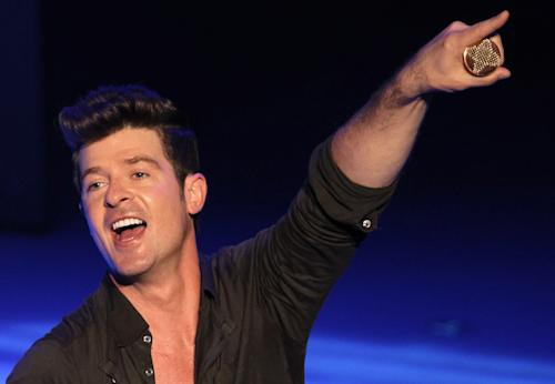 "FILE - In this Sept. 7, 2012 file photo, musician Robin Thicke performs during Macy's Passport presents Glamorama 2012 at The Orpheum Theatre in Los Angeles. Thicke's ""Blurred Lines (feat. T.I. & Pharrell)"" was the top streamed tracks on Spotify from Monday, June 10, to Sunday, June 16, 2013. (Photo by Matt Sayles/Invision/AP, File)"