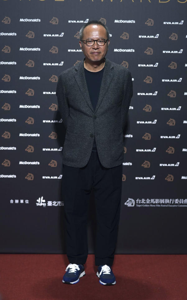 "Taiwanese director Chung Mong-hong arrives at the 56th Golden Horse Awards in Taipei, Taiwan, Saturday, Nov. 23, 2019. Chung is nominated for Best Director for the film ""A Sun"" at this year's Golden Horse Awards -one of the Chinese-language film industry's biggest annual events. (AP Photo/Billy Dai)"