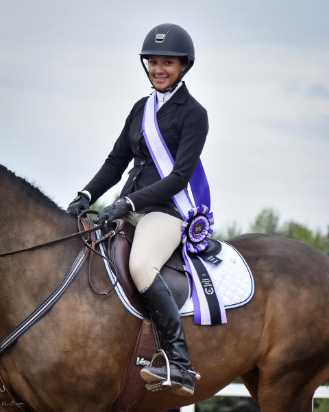 In this undated photo provided by Karie Alderman, Lauryn Gray poses for a photo at the Trillium Championships at Caledon Equestrian Park in Palgrave, Canada. One of the most candid conversations about race in sports is coming from a most unlikely of places: the show-jumping world. Gray, who has one black and one white parent wrote a blog after she was inspired by fellow equestrian Sophie Gochman. (Karie Alderman via AP)
