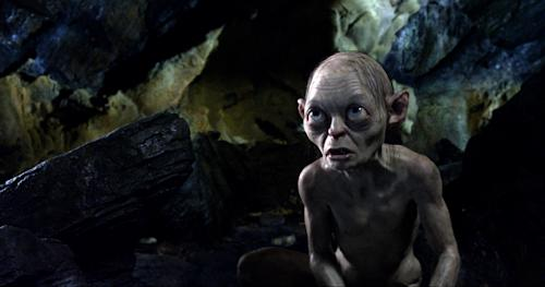 "FILE - This publicity file photo provided by Warner Bros., shows the character Gollum, voiced by Andy Serkis, in a scene from the fantasy adventure ""The Hobbit: An Unexpected Journey."" Making ""The Hobbit"" movie trilogy has cost more than half a billion dollars so far, double the amount spent on ""The Lord of the Rings"" trilogy. That figure includes the major shoots with actors, although there will likely be additional post-production costs as the next two movies are completed. (AP Photo/Warner Bros., File)"