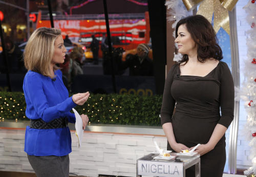 "In this photo provided by ABC, Amy Robach, left, talks with Nigella Lawson at the ABC studio, Thursday, Jan. 2, 2014, in New York. Members of the ""The Taste"" and Lawson appeared on ""Good Morning America,"" Thursday. Lawson testified last month at the fraud trial of two former aides, who were ultimately acquitted of funding a luxury lifestyle with credit cards loaned to them by Lawson and her ex-husband Charles Saatchi. (AP Photo/ABC, Heidi Gutman)"