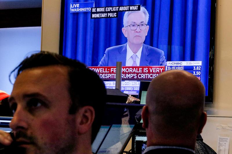 Traders work as a screen shows Federal Reserve Chairman Jerome Powell's news conference after the U.S. Federal Reserve interest rates announcement on the floor of the New York Stock Exchange (NYSE) in New York, U.S., September 18, 2019. REUTERS/Brendan McDermid