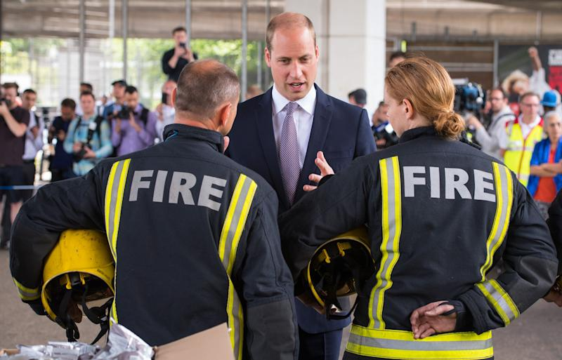 LONDON, ENGLAND - JUNE 16: Prince William, Duke of Cambridge meets firefighters and paramedics during a visit to the Westway Sports Centre which is providing temporary shelter for those who have been made homeless in the disaster on June 16, 2017 in London, England. 30 people have been confirmed dead and dozens still missing, after the 24 storey residential Grenfell Tower block in Latimer Road was engulfed in flames in the early hours of June 14. Emergency services will spend a third day searching through the building for bodies. Police have said that some victims may never be identified. (Photo by Dominic Lipinski - WPA Pool /Getty Images)