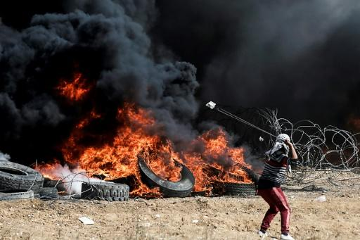 A Palestinian protester uses a slingshot against Israeli forces on April 27, 2018, the fifth straight Friday of mass demonstrations on the Israel-Gaza border
