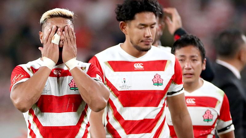 Japanese players, pictured here after their quarter-final loss to South Africa.
