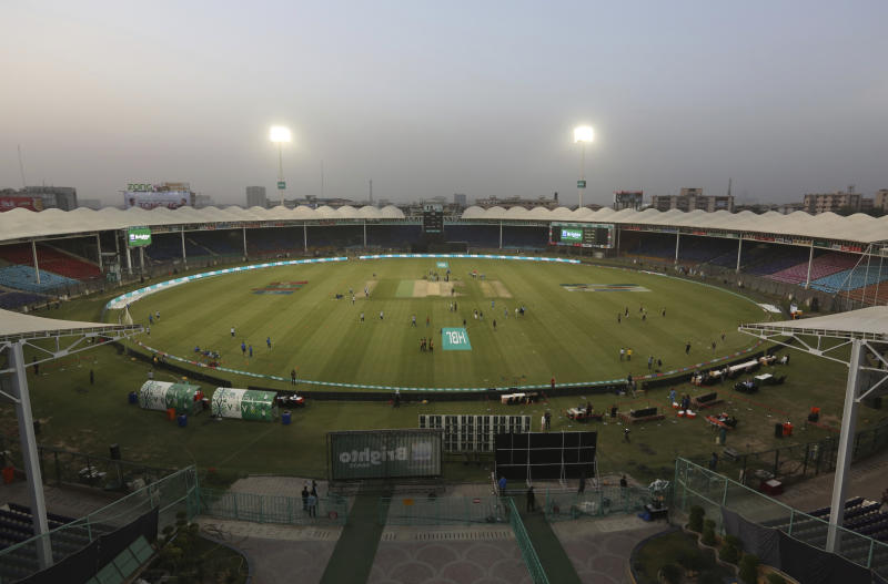 Pakistani cricket teams practice in an empty National Stadium, ahead of their match in the Pakistan Super League in Karachi, Pakistan, Friday, March 13, 2020. The Pakistan Cricket Board decides the Pakistan Super League will go ahead despite the coronavirus outbreak and the withdrawal Friday of 10 foreign players. The vast majority of people recover from the new coronavirus. According to the World Health Organization, most people recover in about two to six weeks, depending on the severity of the illness.  (AP Photo/Fareed Khan)