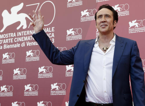 Actor Nicolas Cage poses during the photo call for the movie 'Joe' at the 70th edition of the Venice Film Festival held from Aug. 28 through Sept. 7, in Venice, Italy, Friday, Aug. 30, 2013. (AP Photo/David Azia)