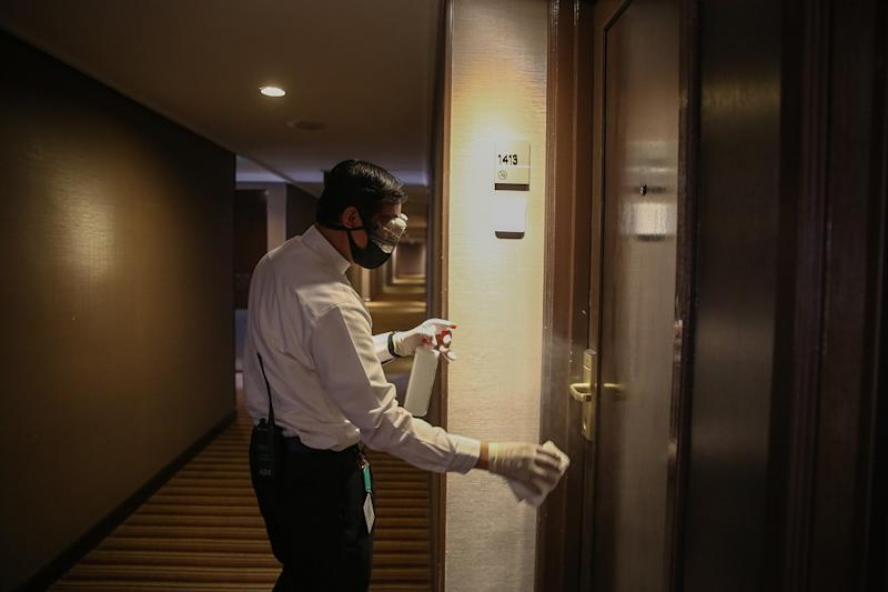 A hotel staff disinfects one of the rooms at the Concorde Hotel in Shah Alam June 9, 2020. — Picture by Yusof Mat Isa