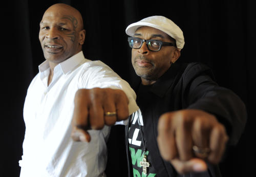 "Spike Lee, right, director of ""Mike Tyson: Undisputed Truth,"" poses with Tyson backstage during HBO's Summer 2013 TCA panel at the Beverly Hilton Hotel on Thursday, July 25, 2013, in Beverly Hills, Calif. The former heavyweight champion teamed with Lee to bring Tyson's one-man stage show to HBO later this year. The program was filmed on Broadway, where ``Mike Tyson: Undisputed Truth'' ran last summer. (Photo by Chris Pizzello/Invision/AP)"