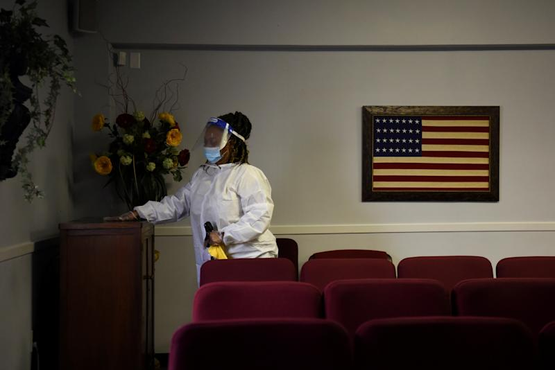 Shayla Williams, 39, disinfects surfaces to prevent the spread of COVID-19 at Beresford Funeral Service in Houston. (Callaghan O'Hare/Reuters)