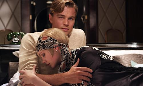 "This film publicity image released by Warner Bros. Pictures shows Carey Mulligan as Daisy Buchanan and Leonardo DiCaprio as Jay Gatsby in a scene from ""The Great Gatsby."" (AP Photo/Warner Bros. Pictures)"