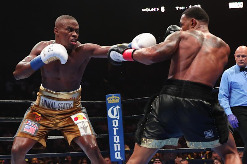 UNIONDALE, NY - AUGUST 04: Peter Quillin (l) lands a left hand against JLeon Love. Quillin would win by unanimous decision at the Nassau Veterans Memorial Coliseum on August 4, 2018 in Uniondale, New York. (Photo by Edward Diller/Getty Images)