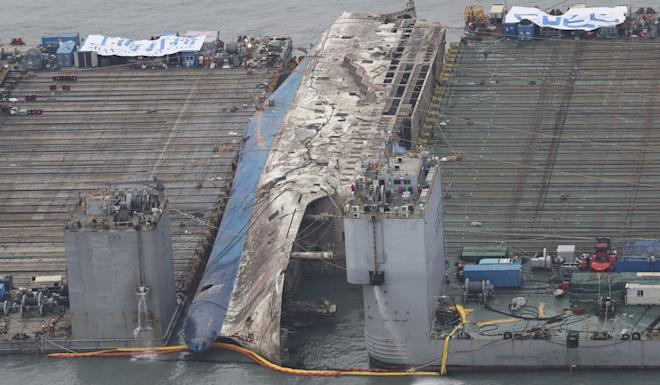 The sunken ferry Sewol is lifted from the water and transported back to land in 2017. Photo: AP
