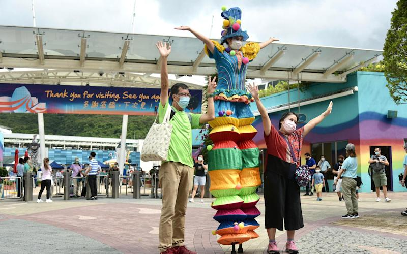 Face coverings are mandatory – even for park performers - Getty
