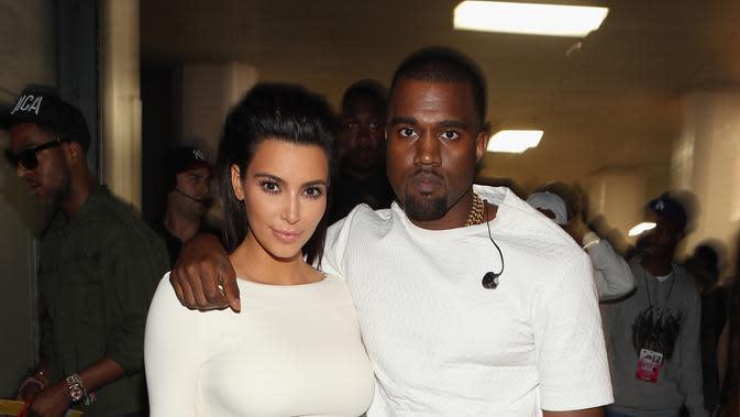Kim Kardashian dan Kanye West. (AFP/Christopher Polk)