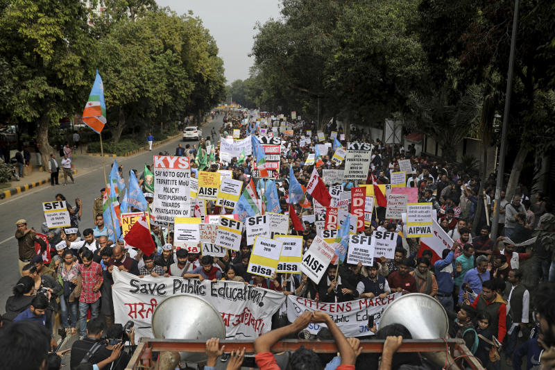 Indian students, activists and members of civil society march towards the Parliament in New Delhi, India, Saturday, Nov. 23, 2019. Hundreds of students of the Jawaharlal Nehru University (JNU) were joined by students from other universities, activists and members of civil society as they marched towards India's parliament to protest against the hostel fee hike, along with their other demands. (AP Photo/Altaf Qadri)