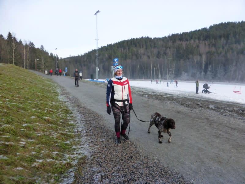 Weekend walker Marie Sten walks with a dog in Oslo