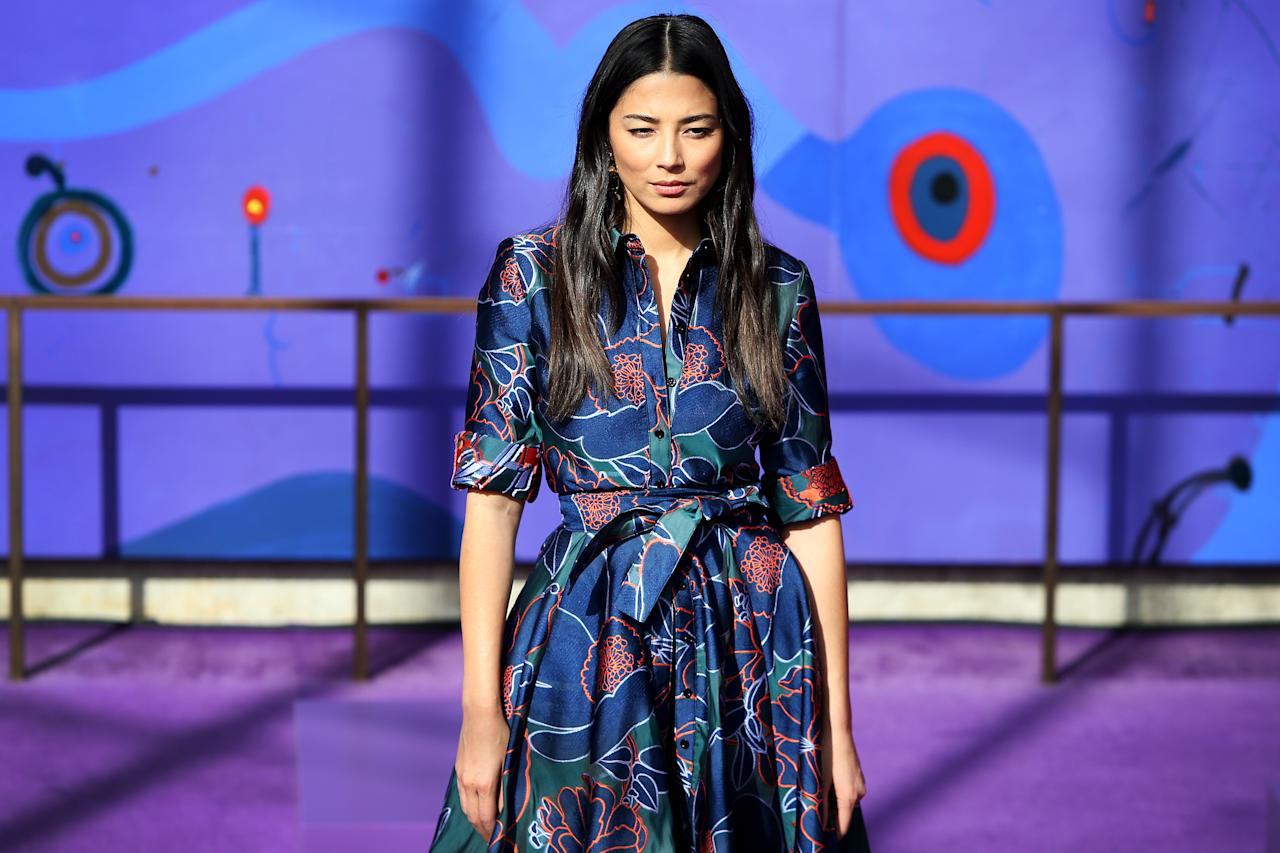 Model Jessica Gomes stuns in this printed design as she leads the runway. Photo: Getty