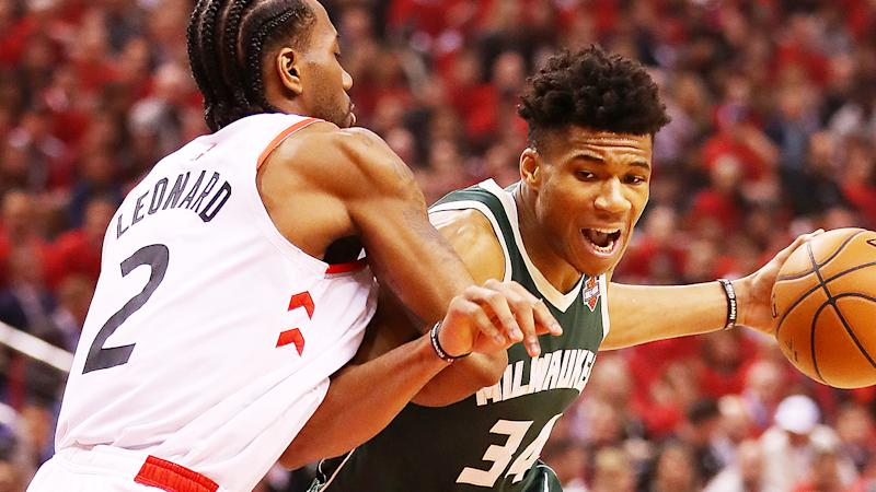 Reigning NBA MVP Giannis Antetokpunmpo, pictured battling Kawhi Leonard, will be a top pick for many fantasy players.