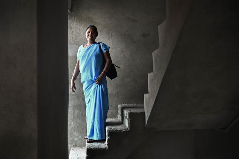 Usha Chaumar stands on the stairs of her newly built three storey house.(Photo by Anindito Mukherjee/SOPA Images/LightRocket via Getty Images)