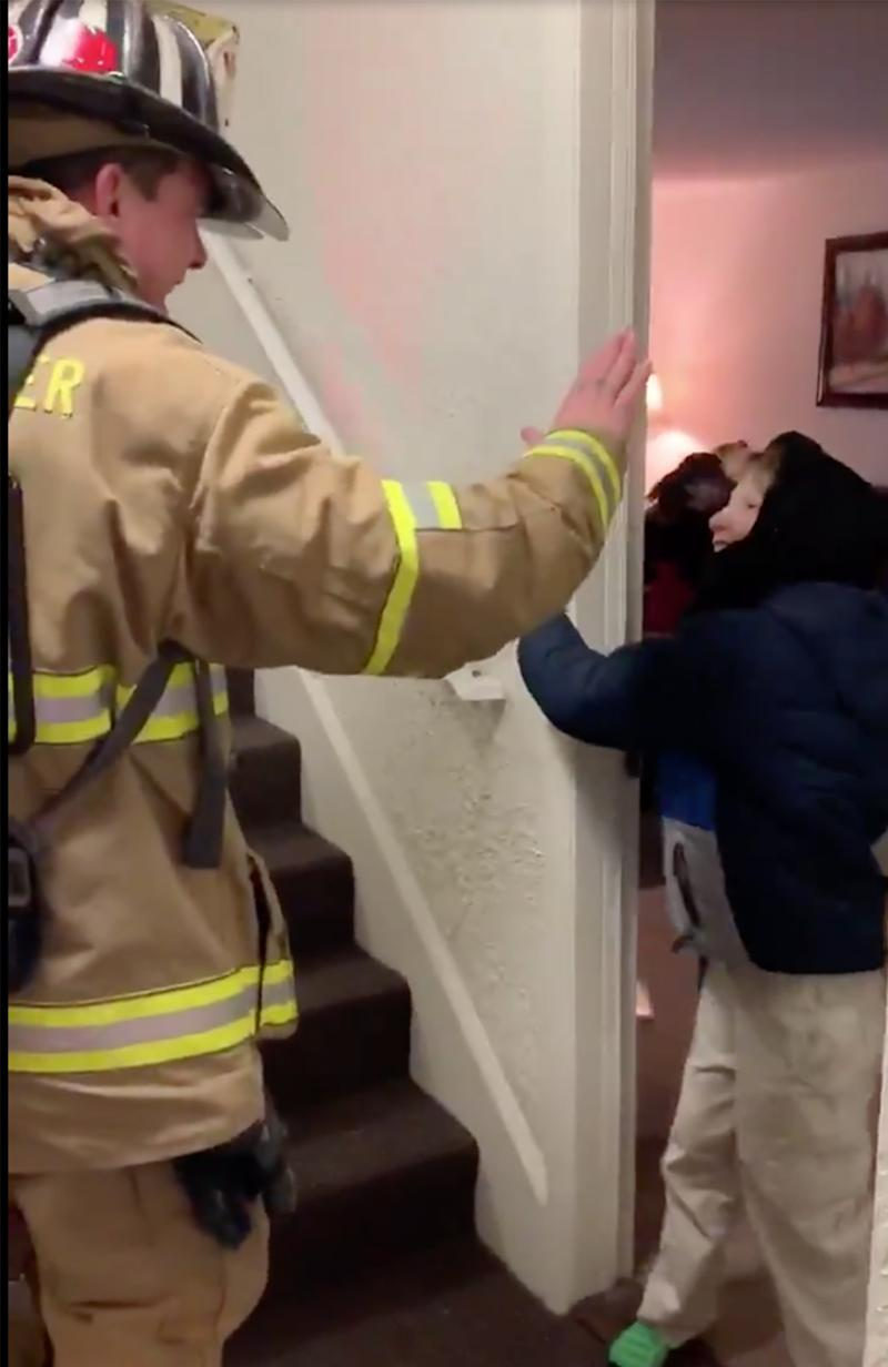 Sign language video: Firefighter Lieutenant Mike Rheault and Tegan exchanged a high five in the stairwell.
