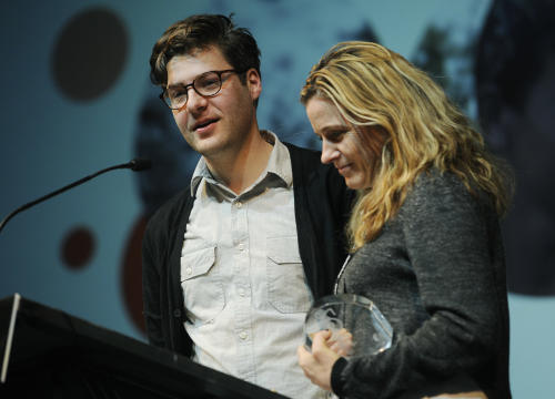 "Andrew Droz Palermo, left, and Tracy Droz Tragos, co-directors of ""Rich Hill,"" accept the Grand Jury Prize: Documentary award for their film during the 2014 Sundance Film Festival Awards Ceremony on Saturday, Jan. 25, 2014, in Park City, Utah. (Photo by Chris Pizzello/Invision/AP)"