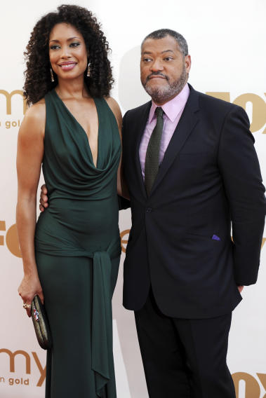 Gina Torres, left, and Laurence Fishburne arrive at the 63rd Primetime Emmy Awards on Sunday, Sept. 18, 2011 in Los Angeles. (AP Photo/Chris Pizzello)
