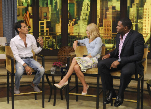 "This image released by Disney-ABC Domestic Television shows Marc Anthony, left, with co-hosts Kelly Ripa, center, and Michael Strahan on ""Live with Kelly and Michael,"" Thursday, July 18, 2013, in New York. Marc Anthony touted his roots on ""Live with Kelly and Michael"" on Thursday after some people criticized his selection to sing ""God Bless America"" at this week's major league baseball All-Star Game, held in New York. The Grammy-winning salsa star said that he heard people were questioning why a foreign-born person was singing the patriotic song. Anthony said he was born in New York and added: ""You can't get more New York than me."" (AP Photo/Disney-ABC Domestic Television, Jeff Neira)"