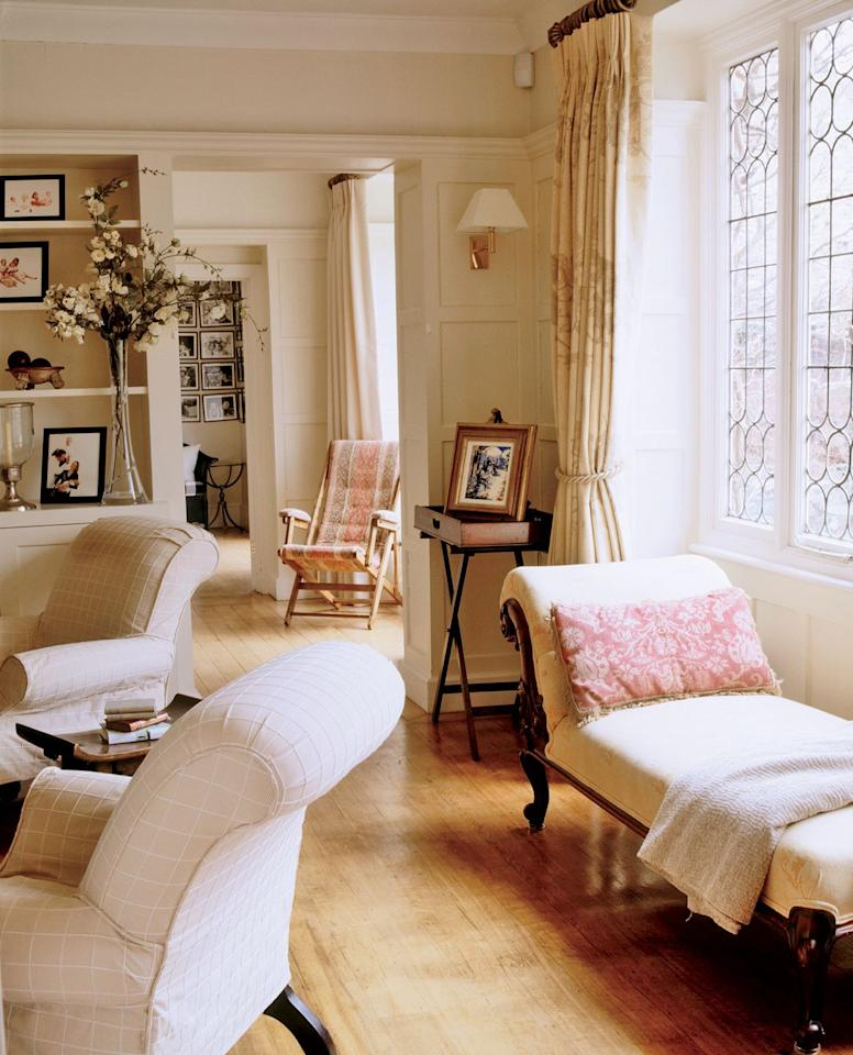<p>Thanks to a simple rope curtain tieback, this well-decorated living room benefits from ample sunlight.  </p>