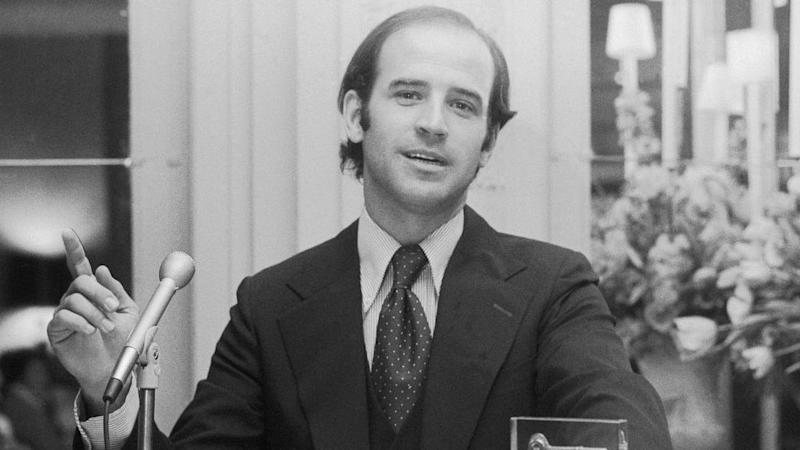 A young, balding Joe Biden sat at his desk in the 1970s.