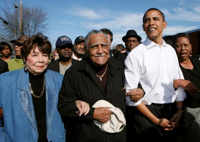 FILE PHOTO: US presidential candidate Senator Obama walks with Reverend Lowery and others during a march in Selma