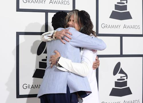 Smokey Robinson, left, and Steven Tyler arrive at the 56th annual Grammy Awards at Staples Center on Sunday, Jan. 26, 2014, in Los Angeles. (Photo by Jordan Strauss/Invision/AP)