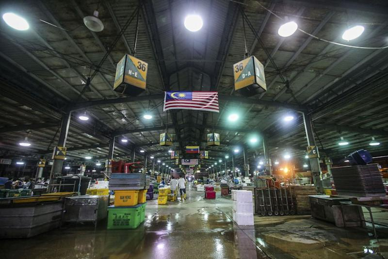 A general view of the Kuala Lumpur Wholesale Market as traders resumed business after the enhanced movement control order on the area was lifted on May 13, 2020. — Picture by Hari Anggara