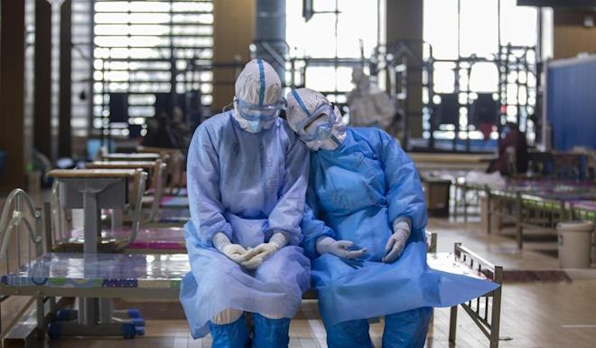 Many of the frontline staff working long hours to fight the disease were women. Photo: Xinhua