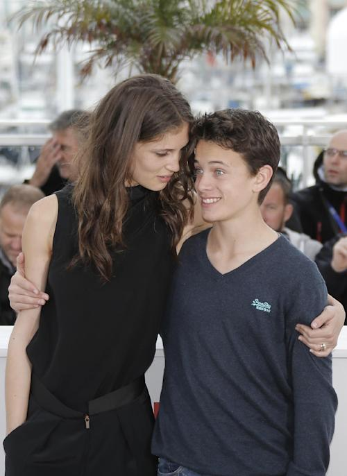 Actress Marine Vacth, left, and actor Fantin Ravat poses for photographers during a photo call for the film Young & Beautiful at the 66th international film festival, in Cannes, southern France, Thursday, May 16, 2013. (AP Photo/Lionel Cironneau)