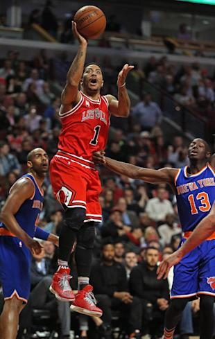Derrick Rose shoots over the man he was traded for. (Jonathan Daniel/Getty Images)