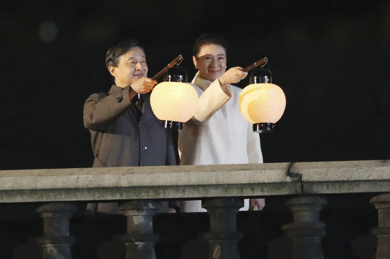 Japanese Emperor Naruhito and Empress Masako hold a lantern during a ceremony to mark his enthronement in Tokyo Saturday, Nov. 9, 2019. Naruhito thanked tens of thousands of well-wishers who gathered outside the palace to congratulate his enthronement at the ceremony organized by conservative political and business groups. (AP Photo/Koji Sasahara, Pool)