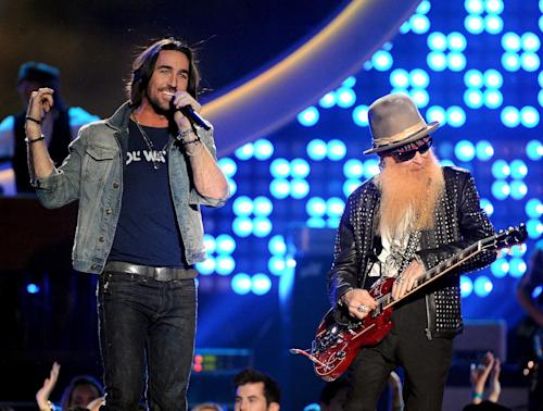 From left, Jake Owens and Billy Gibbons perform onstage at the American Country Awards at the Mandalay Bay Resort & Casino on Tuesday, Dec. 10, 2013, in Las Vegas, Nev. (Photo by Frank Micelotta/Invision/AP)