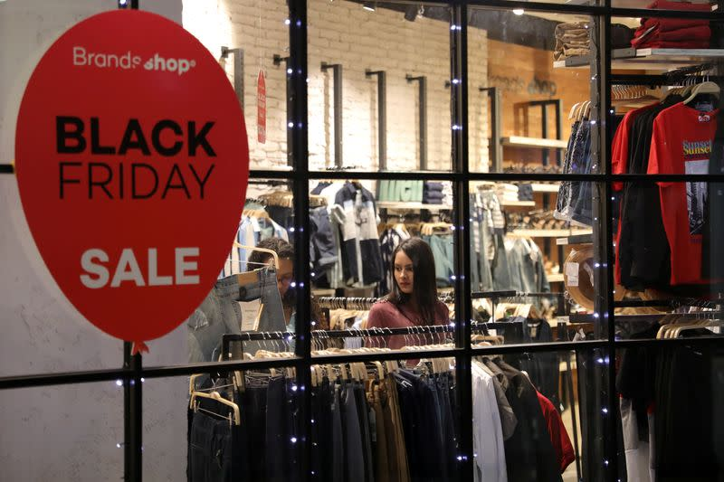 A woman is seen inside a store at a mall during the Black Friday sales in Caracas